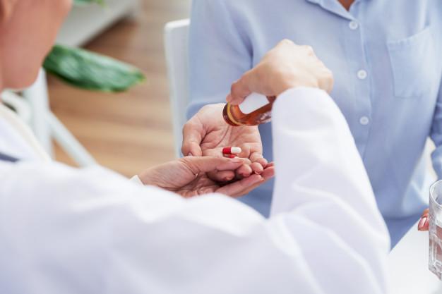 Doctor giving antibiotics to patient.
